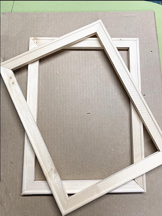 2 wooden deconstructed frames