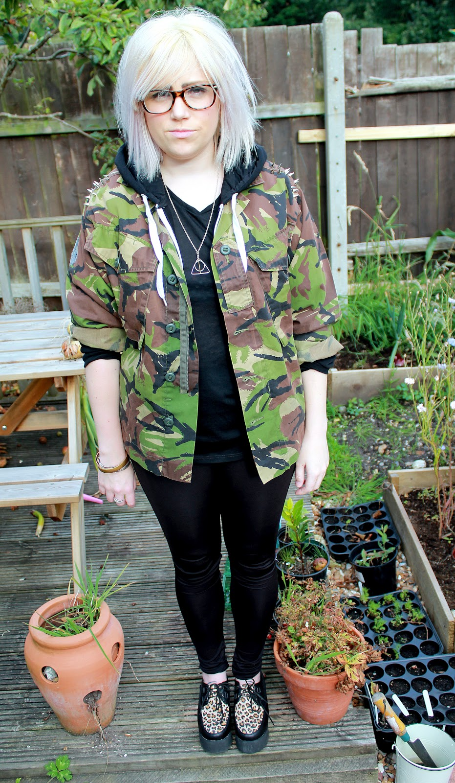 camouflage jacket and creepers