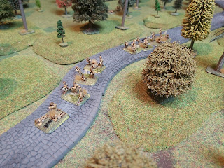 Japanese infantry move slowly down the road