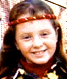 Ann Gotlib | A Young girl with red hair wearing a red headband smiling at the camera | True Crime | mommalovestruecrime.com