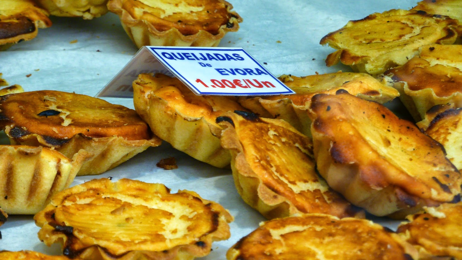 When cycling Portugal, eat delicious cheese tarts from Evora