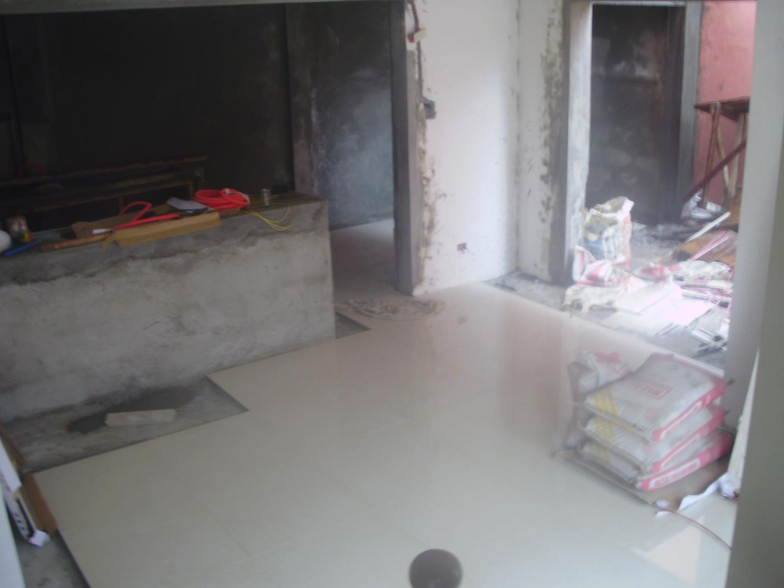 Kitchen Floor Tiling Under Cabinets
