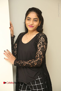 Actress Punarnavi Bhupalam Stills in Black Dress at Pittagoda Press Meet  0033.JPG