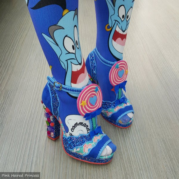 feet with jewelled heels and blue genie tights on legs