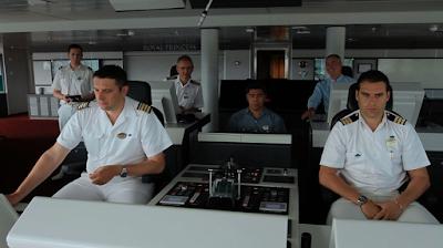 Bridge Officers and Captain on cruise ship bridge Офицеры мостика и капитан на круизном корабле
