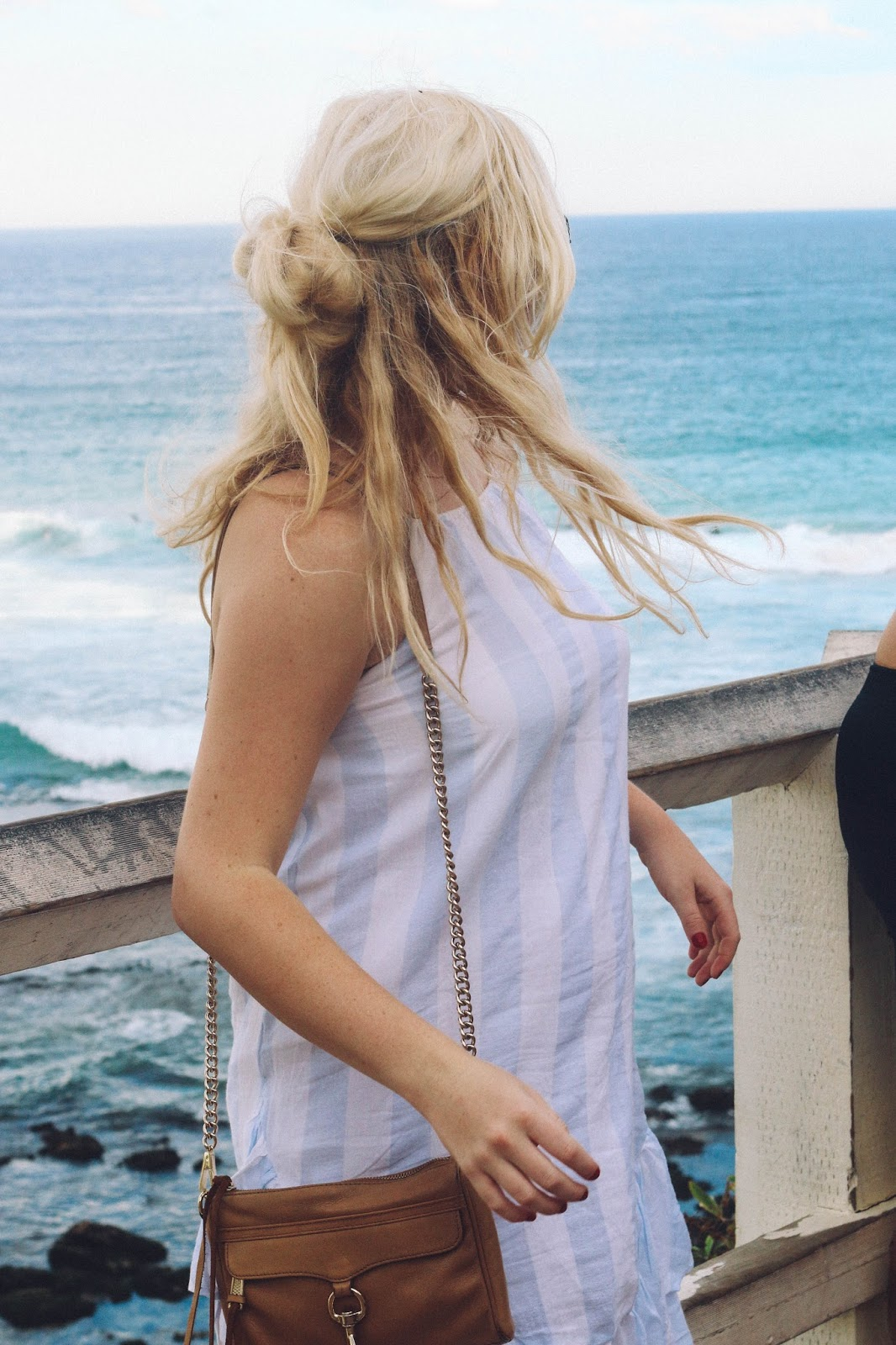 Fashion Blogger (Global Fashion Gal) wearing a blue striped ruffle dress at Bondi Beach in Sydney, Australia.