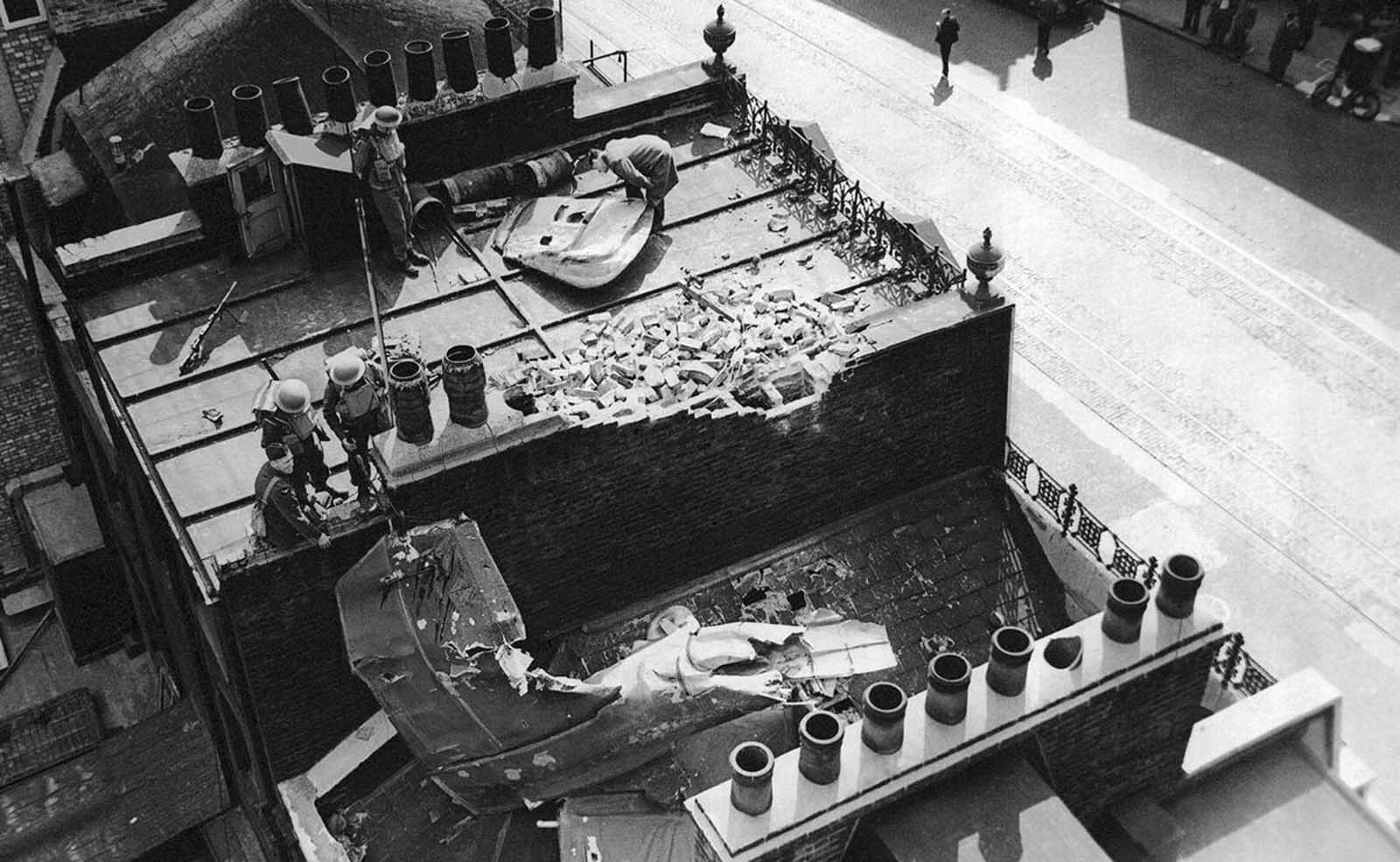 The tail and part of the fuselage of a German Dornier plane landed on a London rooftop shown Sept. 21, 1940, after British fighter planes shot it down on September 15. The rest of the raiding plane crashed near Victoria Station.