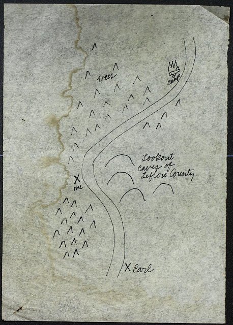 hand drawn fake map with mountains, a river and carl the sasquatch's location. there are fake waterstains on the page