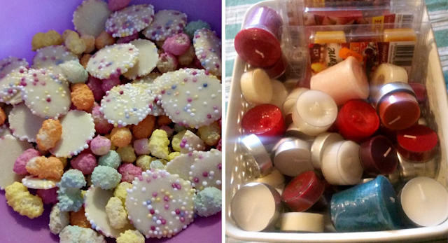 A bowl full of coloured sweets and a box full of wax melts and tea light candles