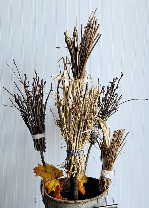 brooms from twigs for halloween decoration