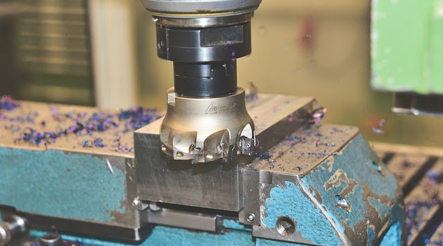 Metal cutting on lathe machine with metal chips.