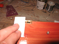 Set the hinges in 1 inch from each side of the case bottom