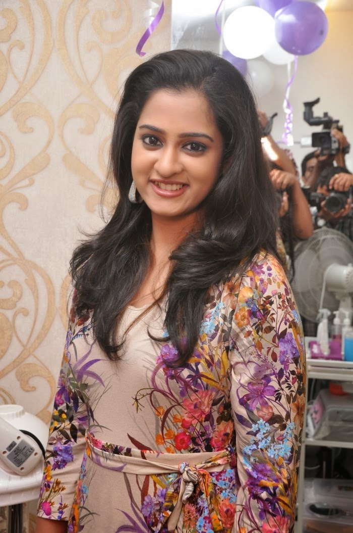 South Indian Actress Nanditha Launches Naturals Family Saloon In Violet Dress