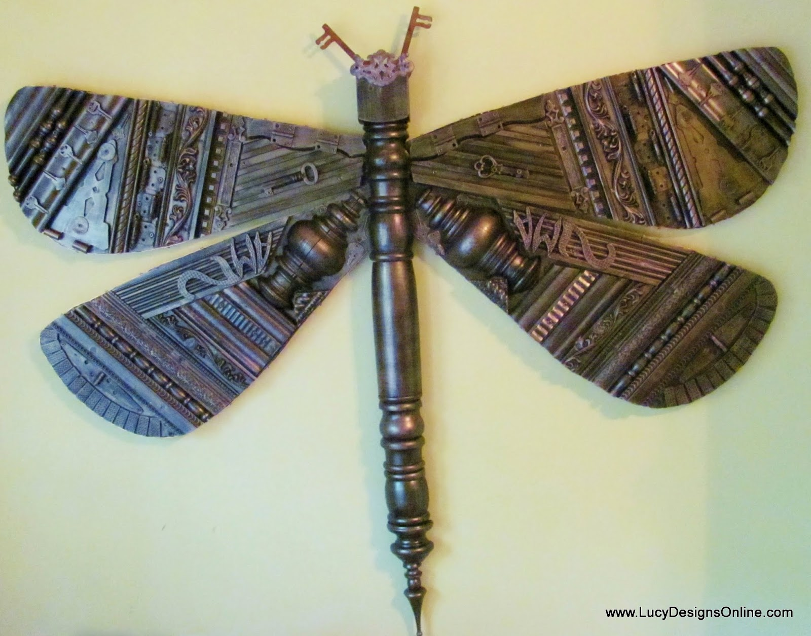 giant recycled elements dragonfly art sculpture industrial look