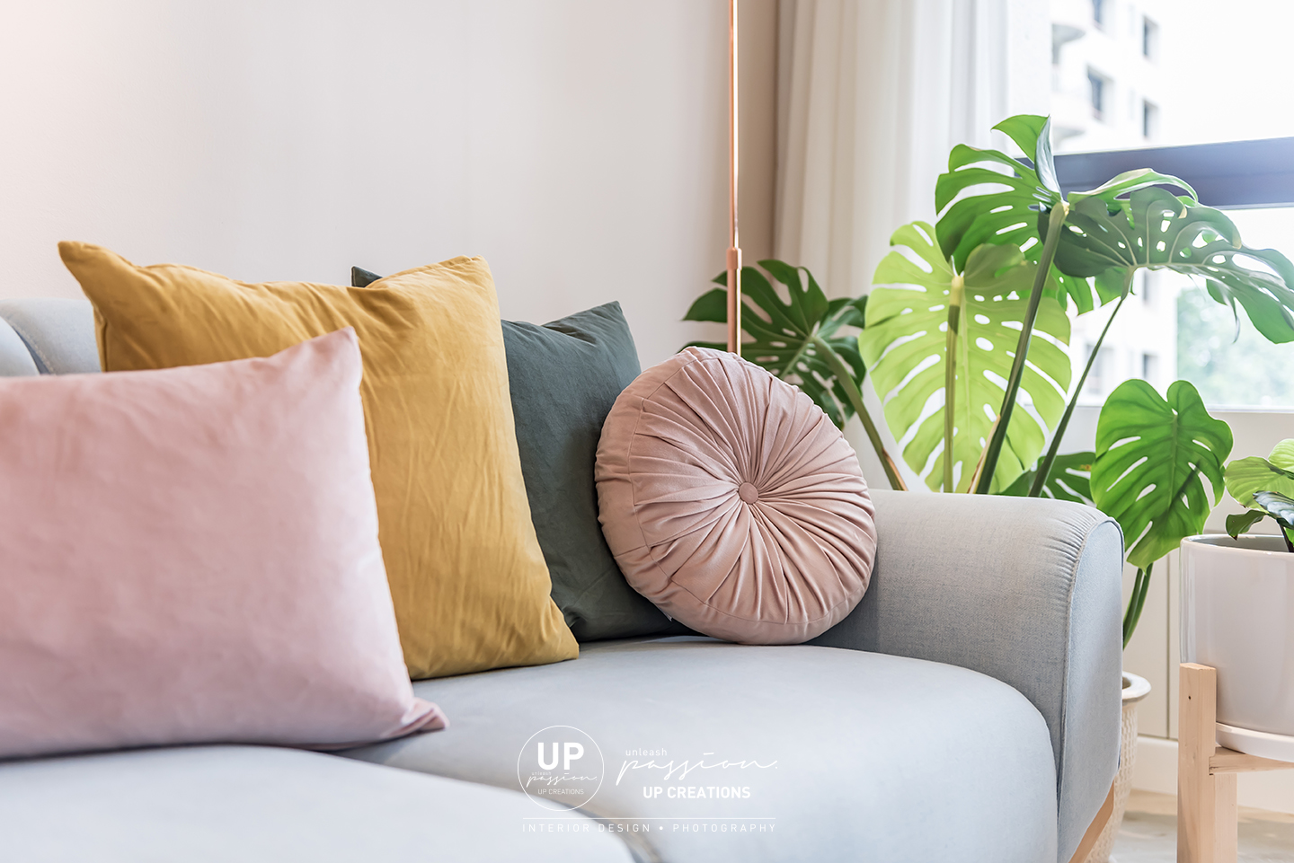 Mont Kiara Pines condo pastel blue sofa with earth tone cushion pillow and plants