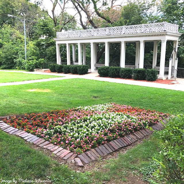 Admiring brilliant blooms at Mount Vernon Gardens in Omaha, Nebraska.