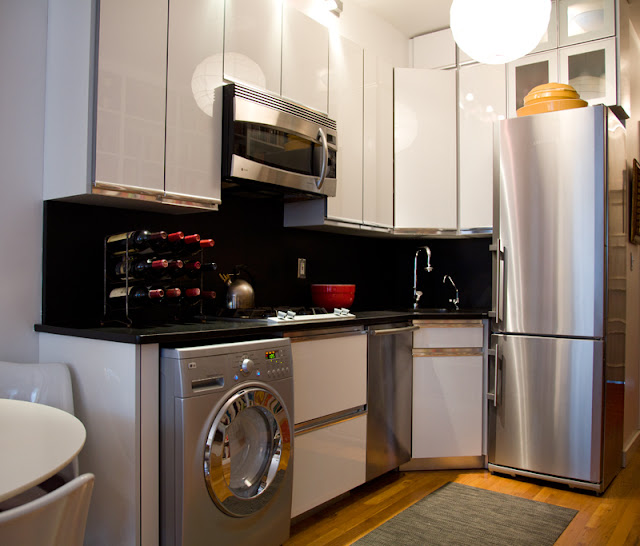Off White Kitchen Cabinets With Slate Appliances: Using The Same Stone On Both Countertop And Backsplash Has