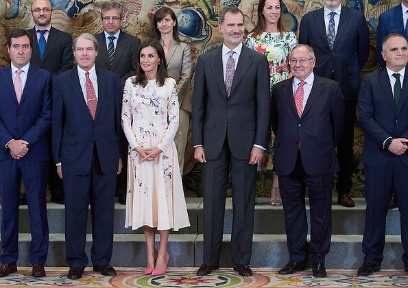 Queen Letizia wore Asos Design Tall midi dress with pretty floral and bird embroidery, and Magrit pink pumps and Magrit pink bag