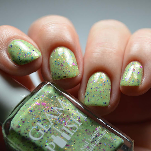 green nail polish with glitter low light swatch