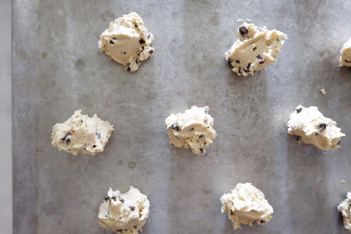 cookie dough balls on insulated baking sheet