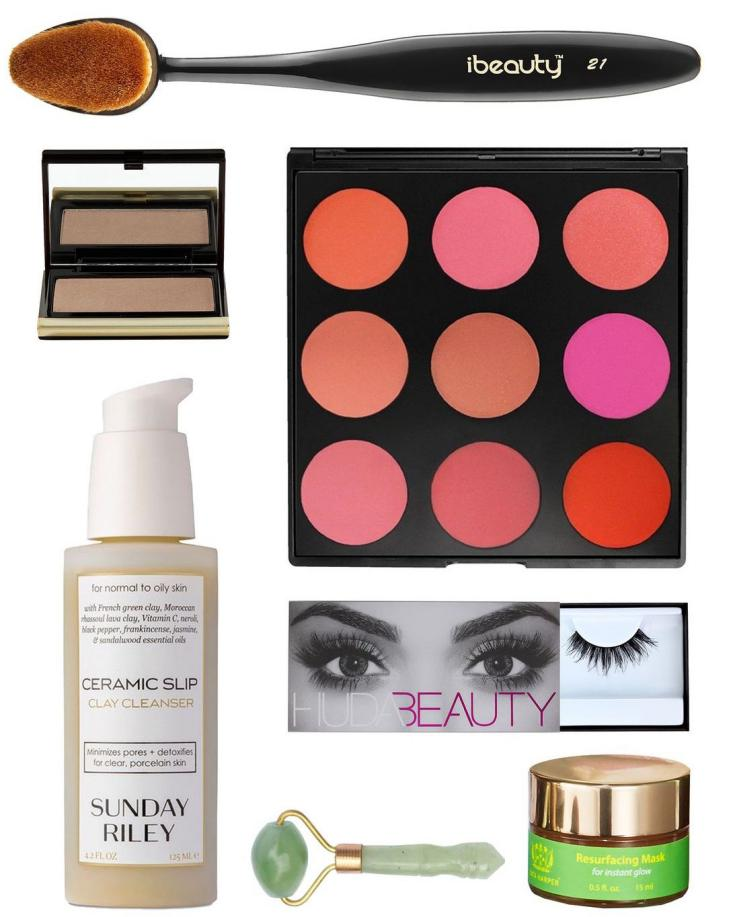 The contents of the Huda Kattan Cult Beauty Box for Fall 2016 - the box ships worldwide and is a selection of Huda Beauty's makeup and skincare must-haves.