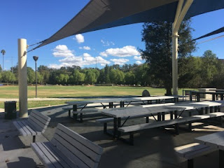Picture of grassy field and picnic tables where the Conejo Valley L.A. Camp Fair takes place Saturday, April 14, 2018.