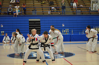 Taekwondo black belt girl practicing self-defense techniques