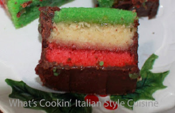 these cookies are made with three colors of the rainbow green, white and red dipped in chocolate