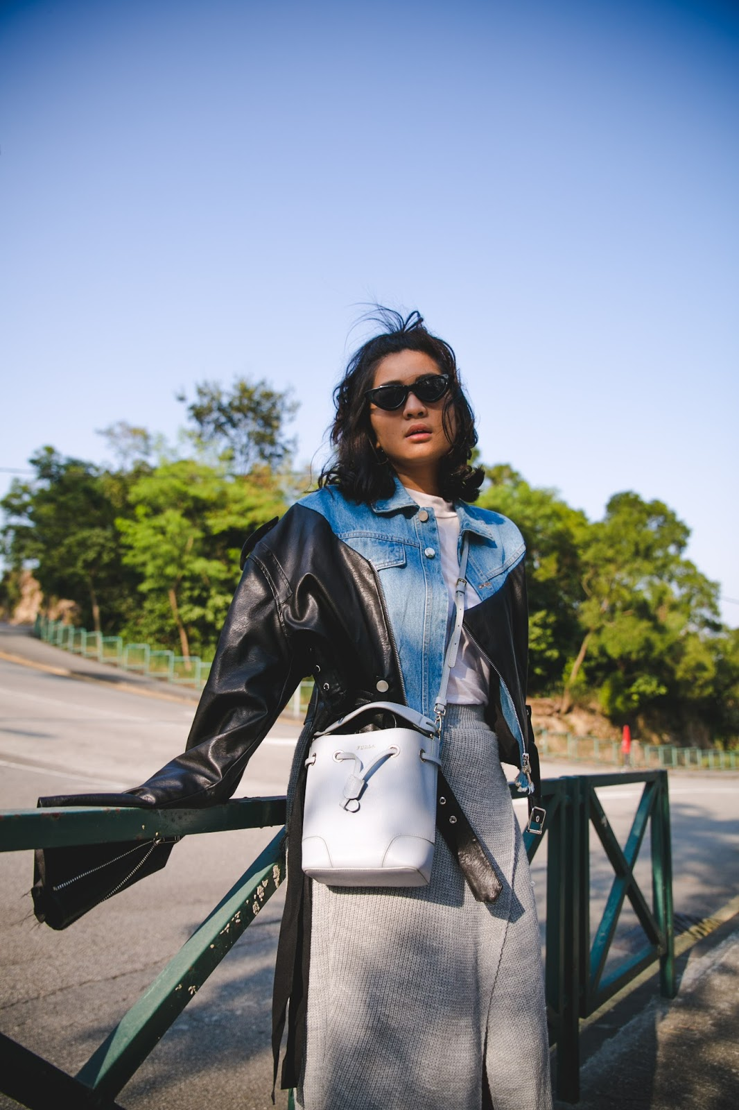 macau fashion blogger wearing denim and leather jacket