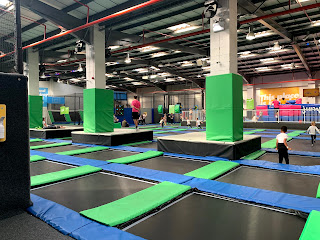 Image of a room filled with trampolines