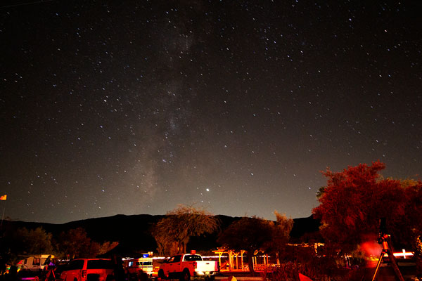 Looking out over some Nightfall scopes at Palm Canyon Resort, with Milky Way overhead (Source: Palmia Observatory)