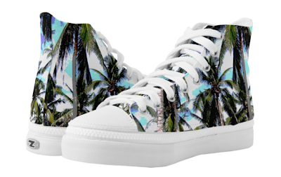 Shoes in a blue and green palm tree pattern