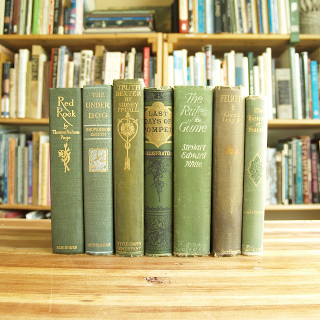 Seven antique books in green bindings