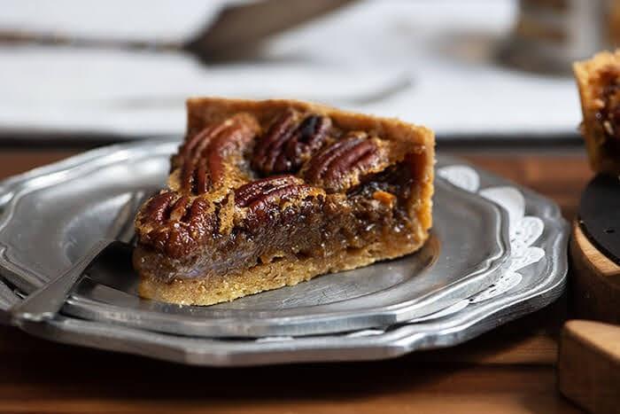 A slice of homemade pecan pie