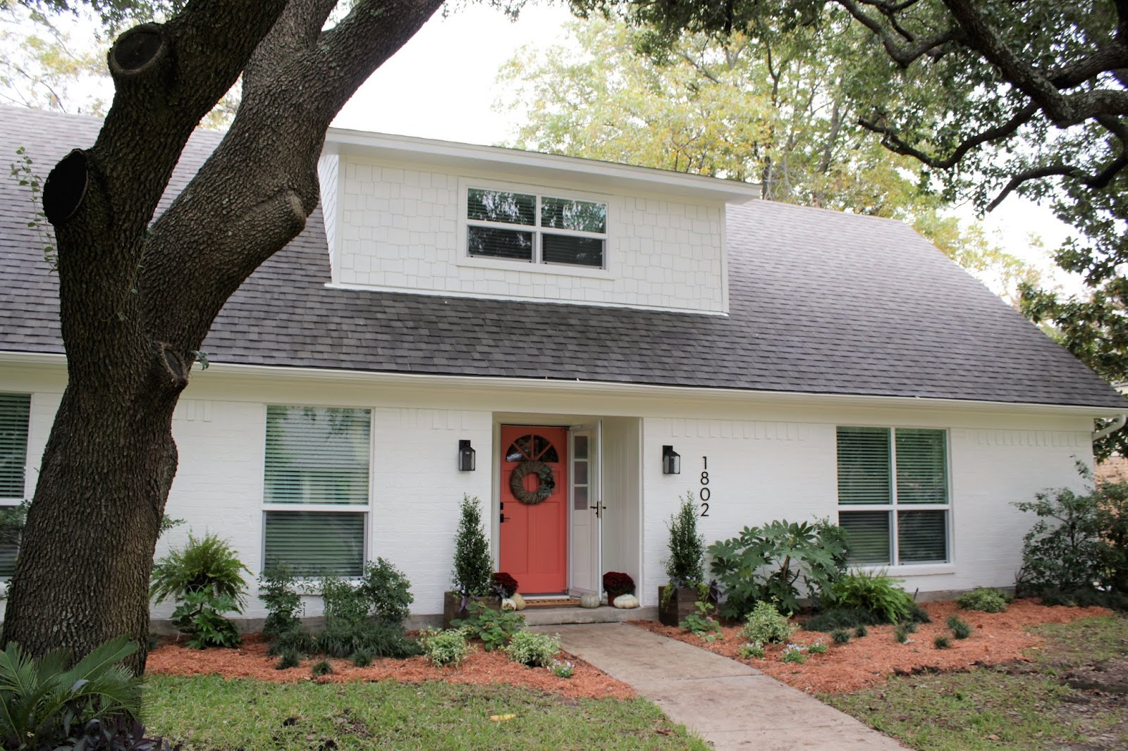 We've lived in our house a whole year!! Check out the tour and a round up of projects I've done. It's been great! | House Homemade white painted exterior
