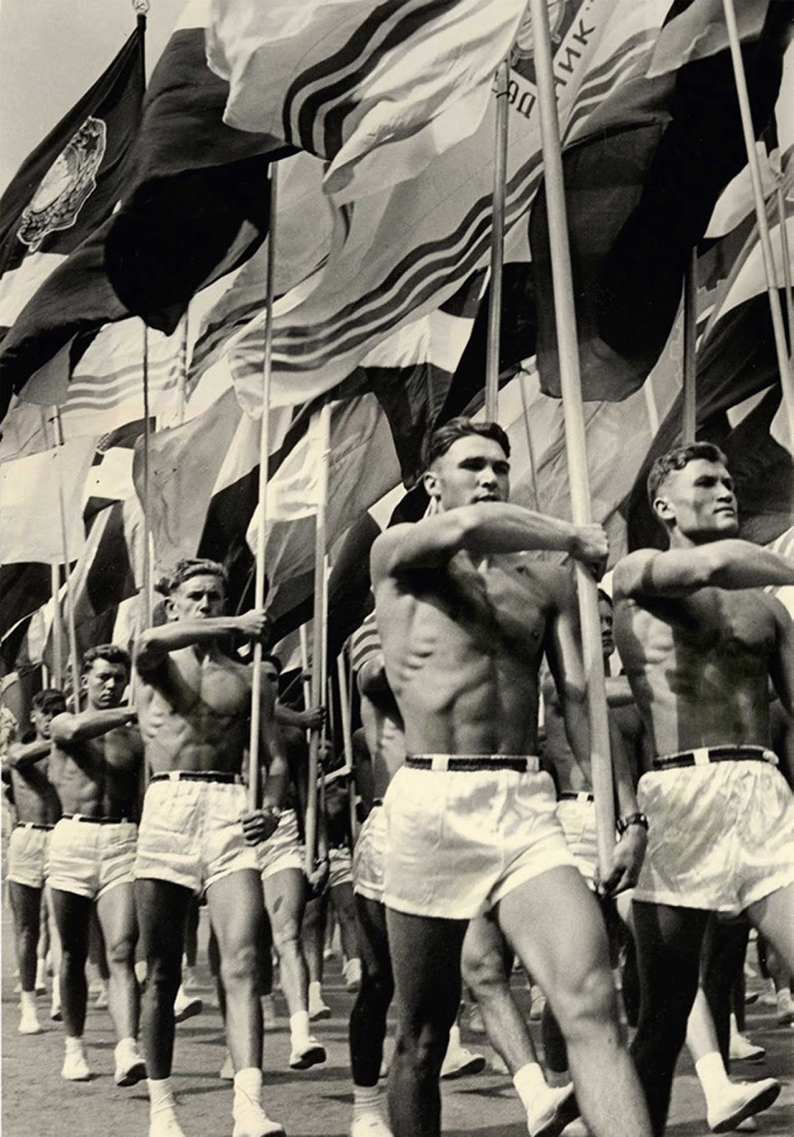Sportsmen's Parade in Moscow, 1956. The best looking ones were put in the front for obvious reasons.
