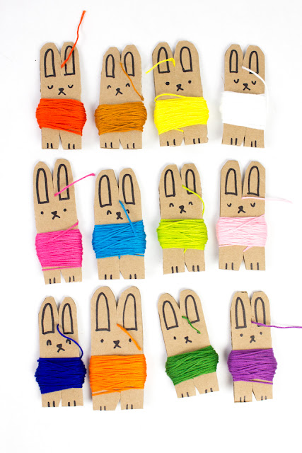 how to make DIY Embroidery floss storage out of cardboard! These cute bunnies are sure to organize all that thread!