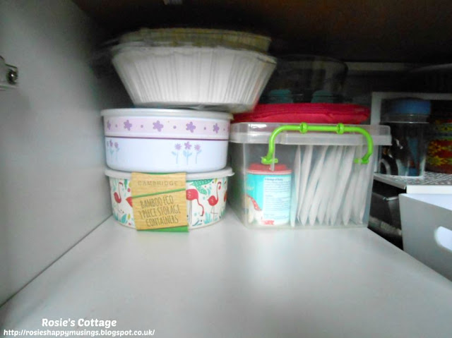 Kitchen Cabinet Re-Organisation: This is a very deep cabinet so I've used this extra space at the back to store an airtight container with (yet more) baking supplies, silicone coated liners for baking trays and two sets of containers, used for fridge storage.