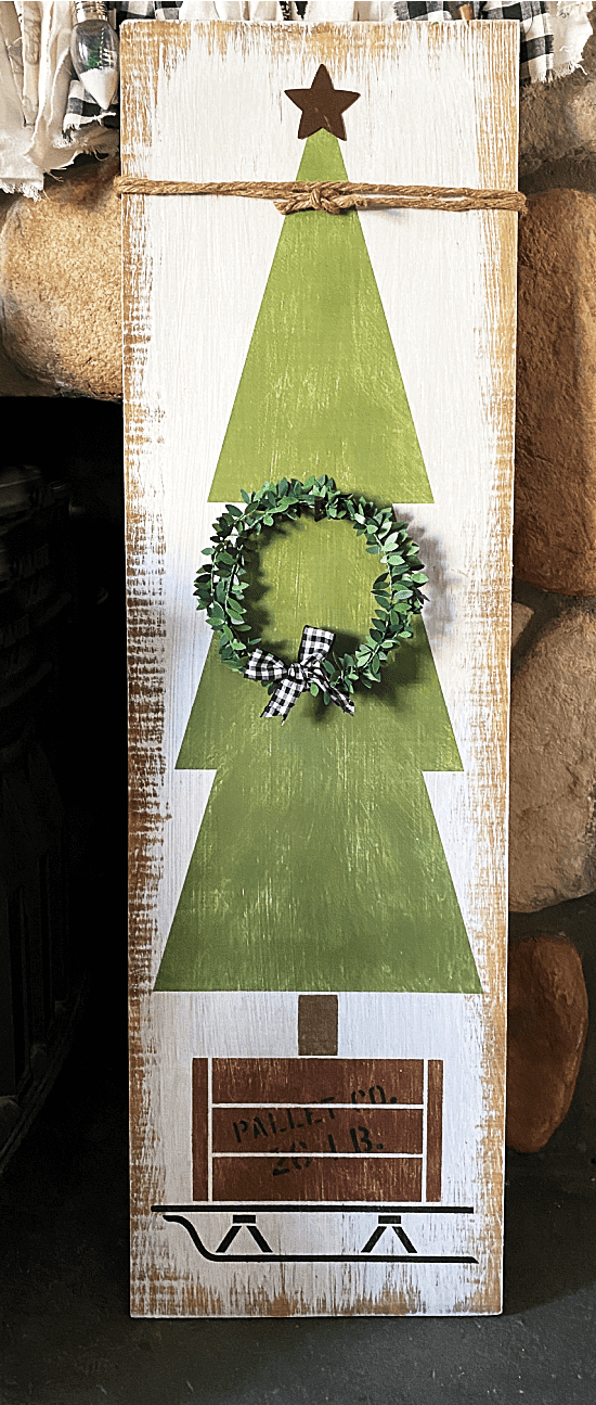 Christmas sign by the fireplace
