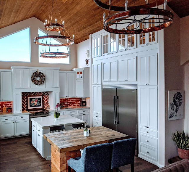 white kitchen with red brick