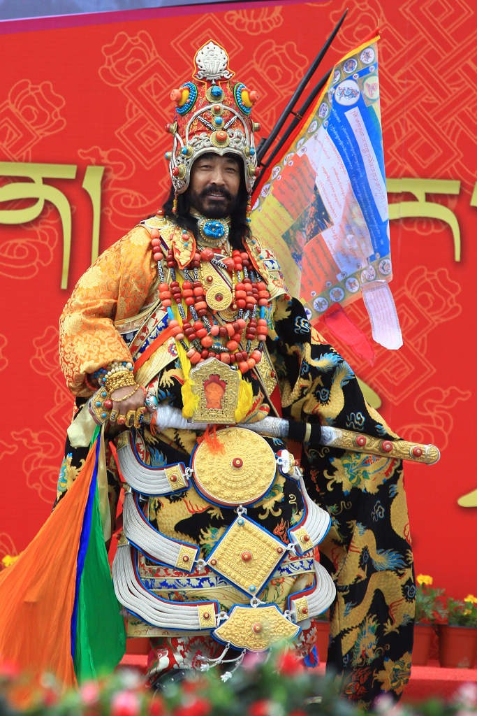 Khampa Tibetan man wearing traditional costume and jewelry during festival