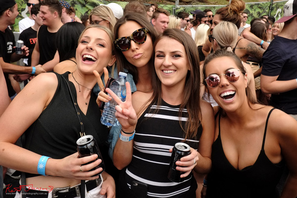 Four young women, girlfriends. Harbour Life Music Festival Sydney 2016. Photographed by Kent Johnson for Street Fashion Sydney.