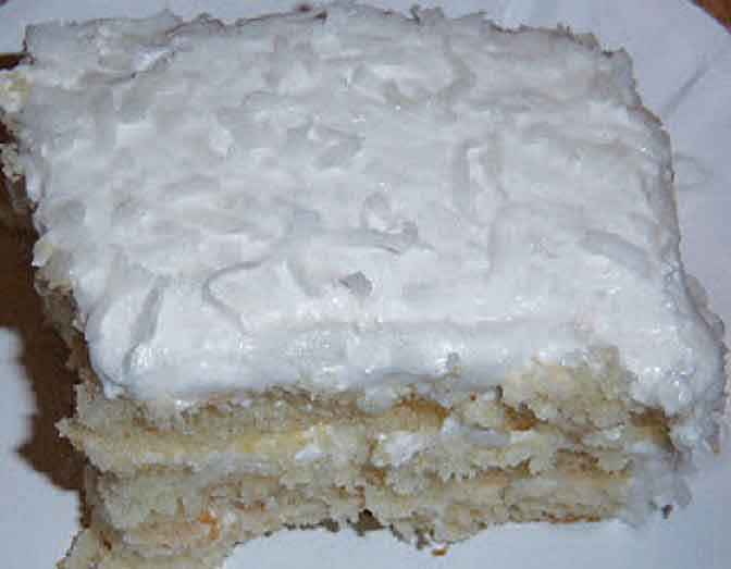 this is a split filled old fashioned coconut cake with frosting