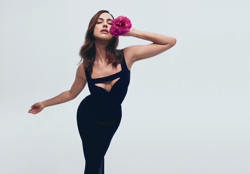 Irina Shayk strikes a pose in Victoria's Secret Bombshell perfume campaign.