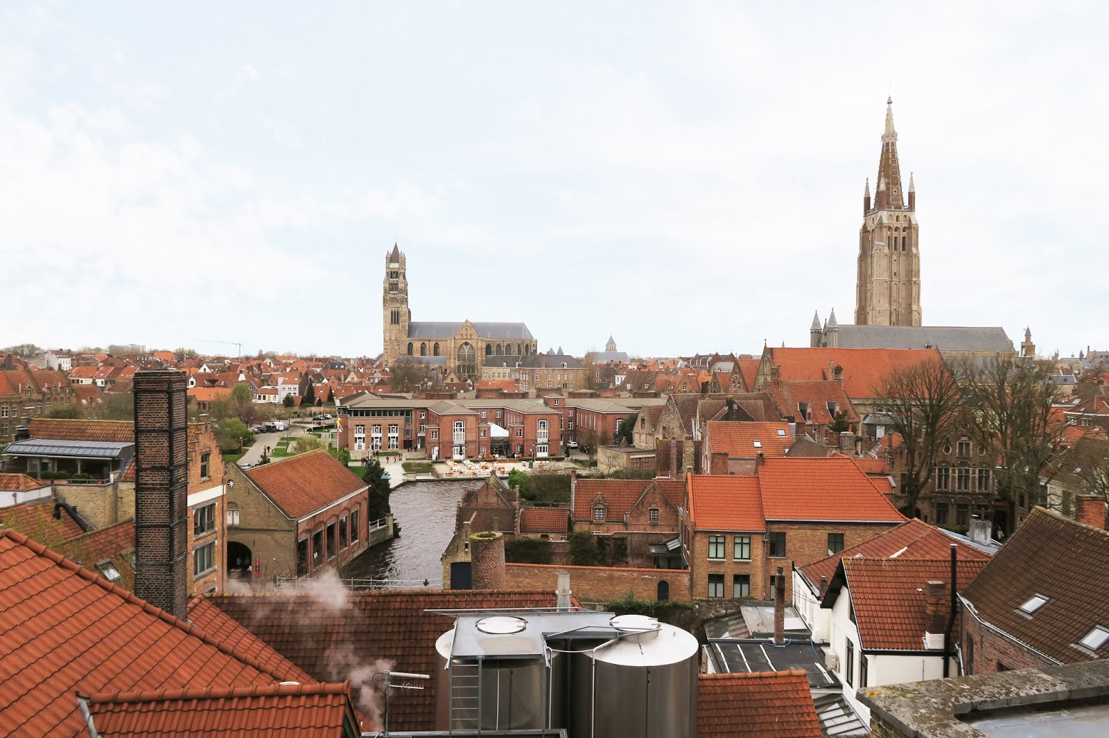 View from De Halve Mann Brewery Bruges. Canals, churches, and homes can be seen across the cityscape.
