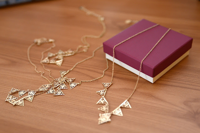 Gold minimalist necklaces and a jewelry box