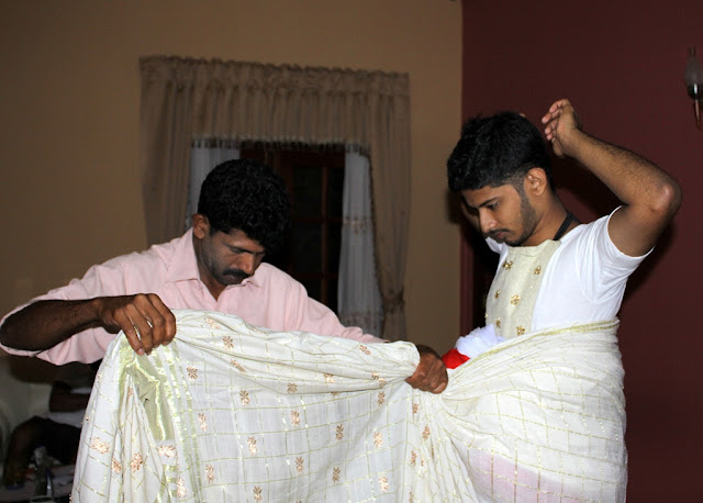 Groom getting dressed in traditional outfit, Sri Lanka