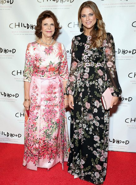 Princess Madeleine wore Giambatista ValliI floral print gown, and she carried Valentino Pink Rockstud clutch bag, Silvia wore a floral dress