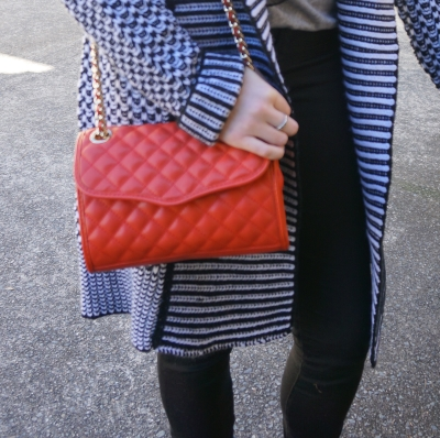 Red Rebecca Minkoff mini quilted affair cross body bag with neutral outfit