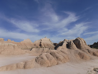 a boy stands atop a rock formation in Badlands National Park
